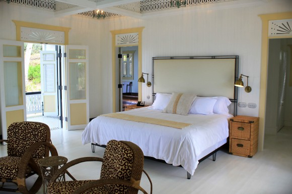 One main room opens into a separate shuttered porch; blurring the line between outside and in. Spacious bathrooms and closets adjoin the main room.